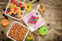 Oatmeal with fruits and yogurt and fruit salad - healthy eating healthy food Royalty Free Stock Images