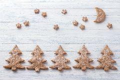 Oatmeal gingerbread cookies in the shape of Christmas tree sprinkled with powdered sugar Stock Images