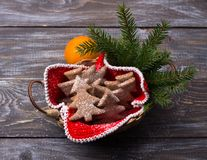 Oatmeal gingerbread cookies in the shape of Christmas tree sprinkled with powdered sugar Stock Image