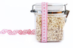 Oatmeal in glass with tape measure Stock Photo