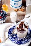 Oatmeal granola glazed with molasses, coffee, milk, fresh berries. Stock Image