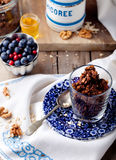 Oatmeal granola glazed with molasses, coffee, milk, fresh berries. Royalty Free Stock Photos