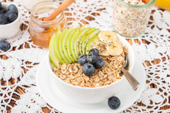 Oatmeal with green Apple, banana, blueberries, honey and Chia seeds Stock Photo