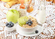 Oatmeal with green Apple, banana, blueberries, honey and Chia seeds Royalty Free Stock Photo