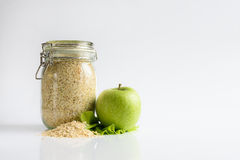 Oatmeal and green apple. Healthy food. Oatmeal and green apple on white background Stock Image