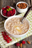 Oatmeal with honey and butter. Vertical Royalty Free Stock Photography