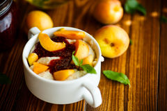 Oatmeal with jam and fresh apricots Stock Images