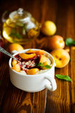Oatmeal with jam and fresh apricots Stock Photo