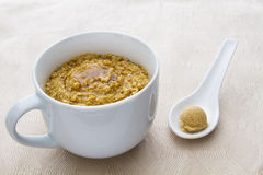 Oatmeal and maple syrup Stock Photography