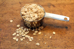 Oatmeal and measuring cup Royalty Free Stock Images