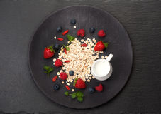 Oatmeal, milk and berries. Stock Image