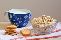 Oatmeal, milk, crackers. Still life. Stock Photography