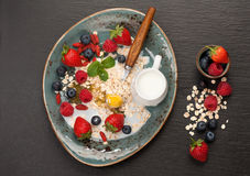 Oatmeal with milk, honey and berries Royalty Free Stock Photos