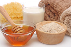 Oatmeal, milk and honey spa stock photo