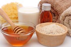 Oatmeal, milk and honey spa Royalty Free Stock Image