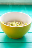 Oatmeal with milk and kiwi in a yellow bowl Royalty Free Stock Photography