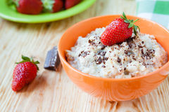 Oatmeal with milk and strawberries Royalty Free Stock Image