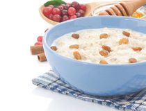 Oatmeal and milk on white Stock Images