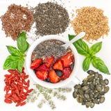 Oatmeal muesli breakfast chia seeds goji berries superfoods Stock Photo