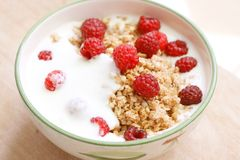 Oatmeal or muesli with yoghurt and fresh raspberries Royalty Free Stock Photo
