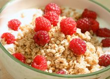 Oatmeal or muesli with yoghurt and fresh raspberries Royalty Free Stock Photography