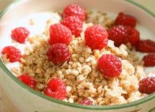 Oatmeal or muesli with yoghurt and fresh raspberries. Healthy breakfast, oatmeal or muesli with yoghurt and fresh raspberries Royalty Free Stock Photography