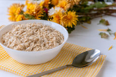 Oatmeal no fundo branco Foto de Stock Royalty Free