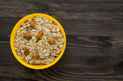 Oatmeal with nuts   almonds . Oatmeal on a wooden table. Oatme Stock Photography