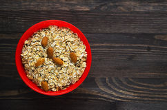 Oatmeal with nuts   almonds . Oatmeal on a wooden table. Oatmea Royalty Free Stock Photography