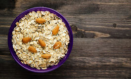 Oatmeal with nuts almonds . Oatmeal on a wooden table. Oatmeal t Royalty Free Stock Photography