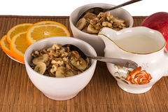 Oatmeal with nuts, bananas, oranges and apples Royalty Free Stock Images