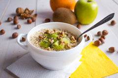 Oatmeal with nuts and fruits for breakfast stock photos