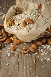 Oatmeal with nuts in paper bag Stock Photos