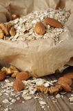 Oatmeal with nuts in paper bag Stock Images