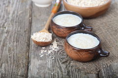 Oatmeal on old wooden table Stock Images