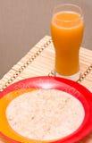 Oatmeal and orange juice. Breakfast - oatmeal porridge and orange juice Royalty Free Stock Photo