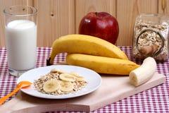 Oatmeal with organic banana Royalty Free Stock Photos