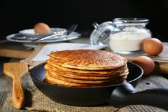 Oatmeal pancakes in a frying pan. royalty free stock images