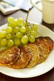 Oatmeal pancakes and grapes Royalty Free Stock Photography