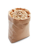 Oatmeal. In paper bag isolated on white stock photo