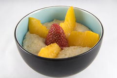 Oatmeal with Peaches and Strawberry--Isolated Royalty Free Stock Image