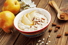 Oatmeal with pear and almonds Stock Image