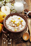 Oatmeal with pear and cinnamon Stock Photography