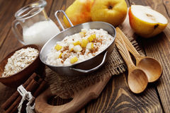 Oatmeal with pear and cinnamon Royalty Free Stock Image
