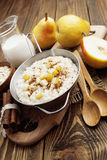 Oatmeal with pear and cinnamon Stock Image