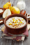 Oatmeal with pear and cinnamon Royalty Free Stock Photography