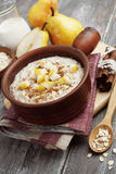Oatmeal with pear and cinnamon Stock Images
