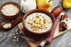 Oatmeal with pear and cinnamon Stock Photos
