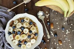 Oatmeal Pecans Bananas and Blueberries royalty free stock photo