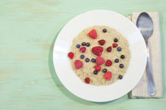 Oatmeal in plate on wooden background Stock Image